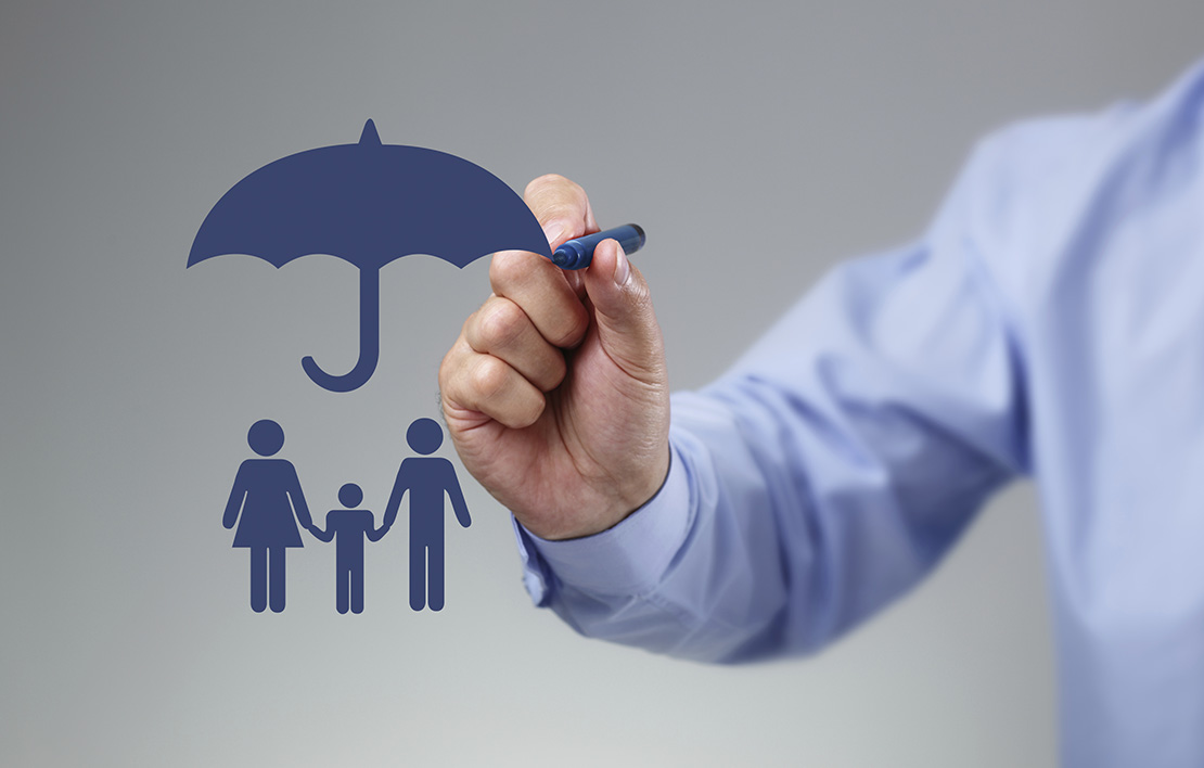 Man drawing an umbrella over a man, woman, and child holding hands