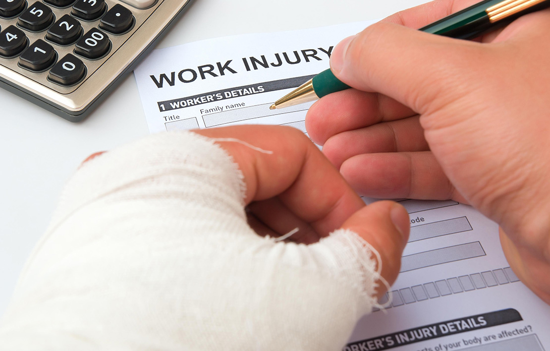 Male with broken airmailing out a Work Injury form